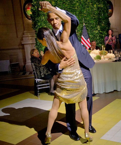 President Barack Obama tangos with a dancer during the state dinner at the Centro Cultural Kirchner, Wednesday, March 23, 2016, in Buenos Aires.