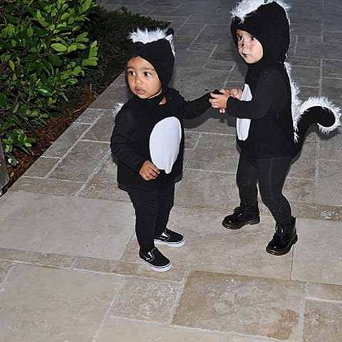 North West and Penelope Disick dressed as skunks for Halloween