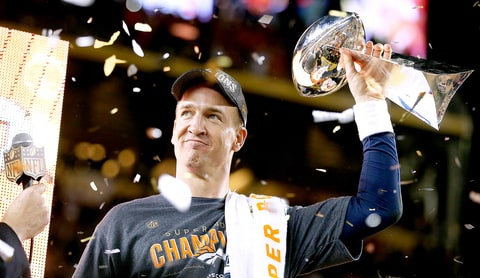 Peyton Manning #18 of the Denver Broncos celebrates with the Vince Lombardi Trophy after Super Bowl 50 at Levi's Stadium on February 7, 2016.