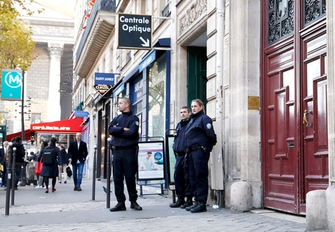 Police officers stand guard at the entrance to a hotel residence at the Rue Tronchet, near Madeleine, central Paris, on October 3, 2016, where US reality television star Kim Kardashian was robbed at gunpoint by assailants disguised as police.
