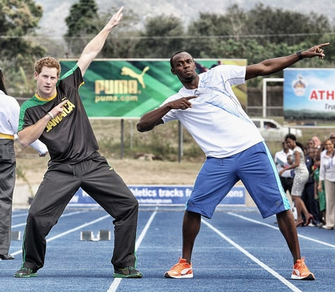 Prince Harry races Usain Bolt at the Usain Bolt Track at the University of the West Indies on March 6, 2012 in Kingston, Jamaica.