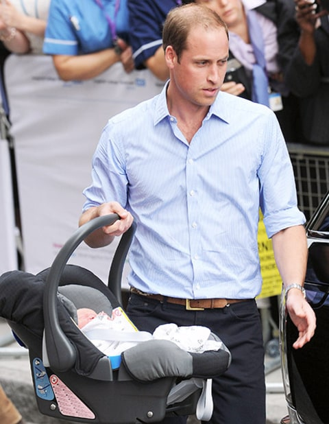 Prince William and George in carseat