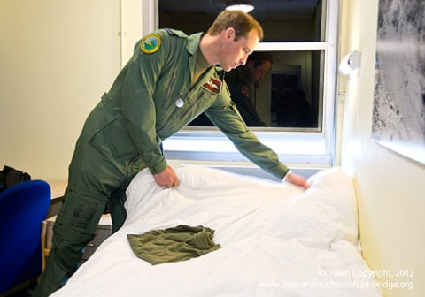 Prince William making bed