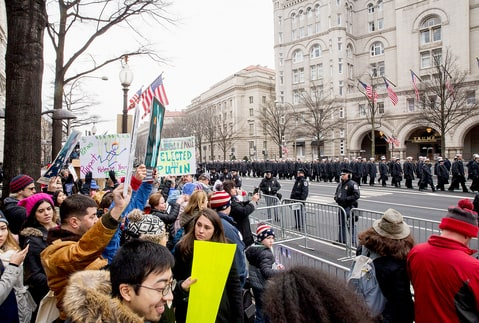 Protesters against and supporters of Donald Trump gather prior to the presidential inauguration in front of the Trump Hotel on January 20, 2017 in Washington, DC.