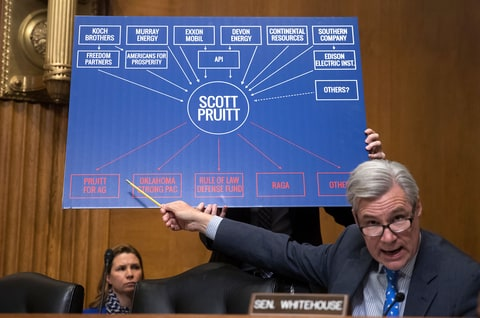 Senate Environment and Public Works Committee member Sen. Sheldon Whitehouse, D-R.I., points to a chart as he questions Environmental Protection Agency Administrator-designate, Oklahoma Attorney General Scott Pruitt, on Capitol Hill in Washington, Wednesday, Jan. 18, 2017, during Pruitt's confirmation hearing before the committee