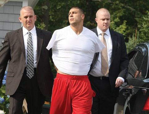 New England Patriots tight end Aaron Hernandez was arrested and led out of his home in handcuffs, shortly before 9 a.m. It is not immediately known what charges he is facing, but he has been under investigation in connection with the murder of Odin Lloyd.