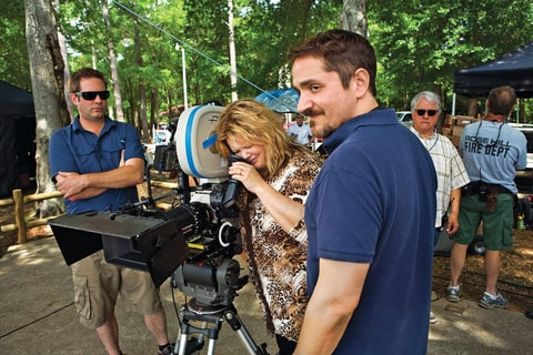 McCarthy on the set of 'Tammy' with her husband - the film's director - Ben Falcone (right).