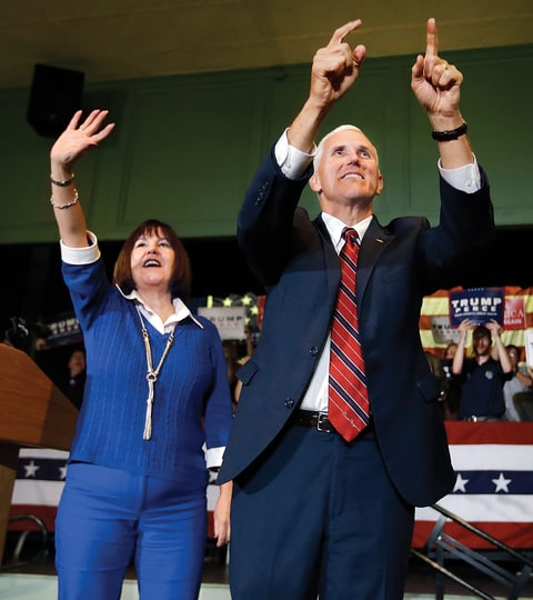Pence at a presidential campaign stop in Exeter, New Hampshire, with his wife, Karen.