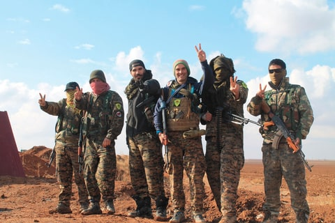 Franceschi (third from left) has recruited a group of Western leftists to join the Rojava Revolution.