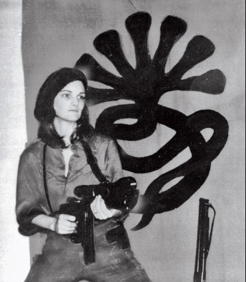 Hearst after her abduction in a photo released by Symbionese Liberation Army.