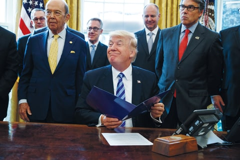 President Donald Trump, flanked by Commerce Secretary Wilbur Ross, left, and Energy Secretary Rick Perry, is seen in the Oval Office of the White House in Washington Friday, March 24, 2017, during the announcing of the approval of a permit to build the Keystone XL pipeline, clearing the way for the $8 billion project.