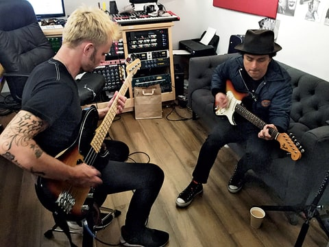Dirnt and Armstrong in the band's new studio in Oakland, working on Revolution Radio.