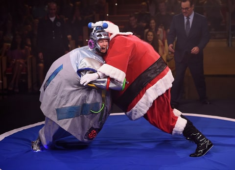 Renee Zellweger and Jimmy Fallon wrestle in inflatable suits