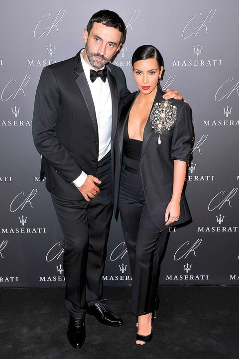 Riccardo Tisci and Kim Kardashian attend the CR Fashion Book Issue No.5 Launch Party Hosted by Carine Roitfeld and Stephen Gan at The Peninsula Paris on September 30, 2014 in Paris, France.