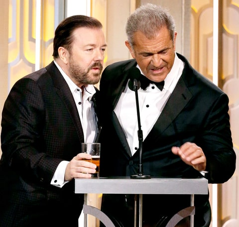 Ricky Gervais and presenter Mel Gibson speak onstage during the 73rd Annual Golden Globe Awards.