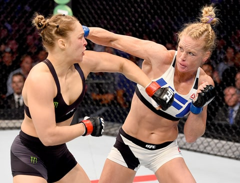 Holly Holm of the United States punches Ronda Rousey of the United States in their UFC women's bantamweight championship bout during the UFC 193 event at Etihad Stadium on November 15, 2015 in Melbourne, Australia.