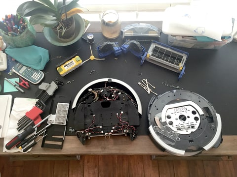 The disassembled Roomba