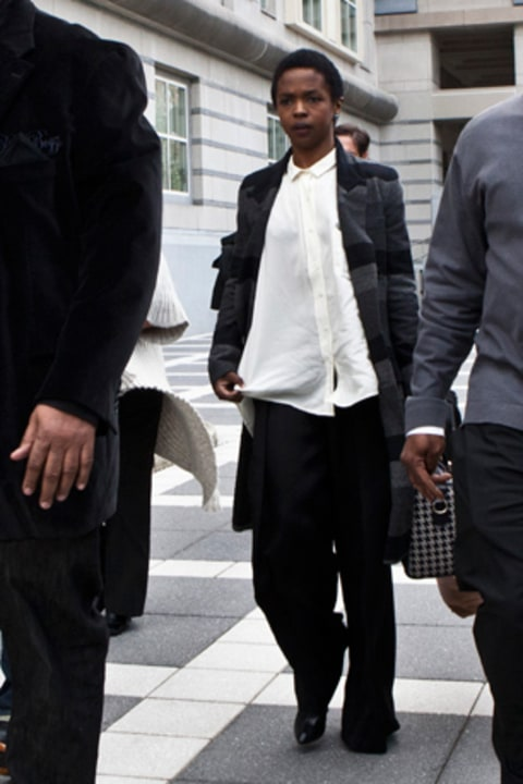 Lauryn Hill is seen leaving court after pleading guilty to tax evasion charges.