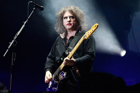 Robert Smith of The Cure performs at Lollapalooza 2013 at Grant Park in Chicago, Illinois.