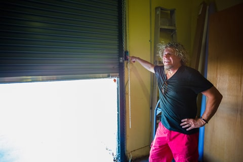 Sammy Hagar opens the door to his car hanger.