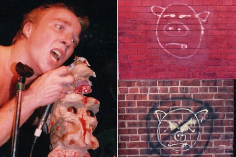 "GWAR member Dave Brockie with ""Uncle Knobby"" stage prop; Death Piggy Double graffiti."