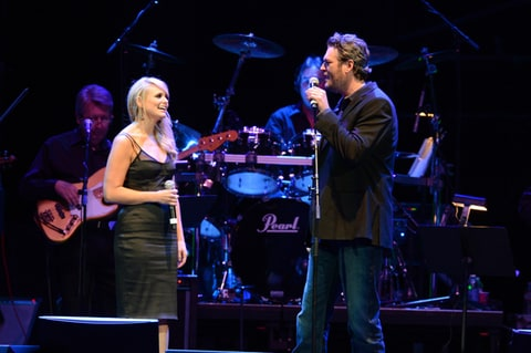Miranda Lambert and Blake Shelton performs during Playin' Possum! The Final No Show Tribute To George Jones at Bridgestone Arena on November 22, 2013 in Nashville, Tennessee.
