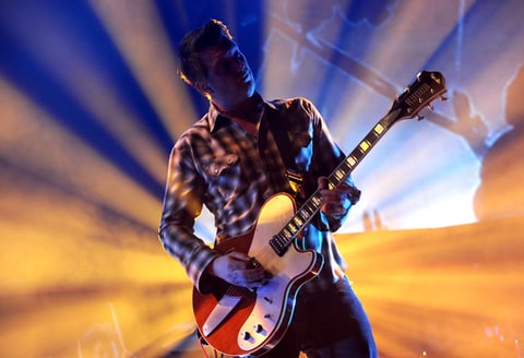 Josh Homme of Queens of the Stone Age performs during The 24th Annual KROQ Almost Acoustic Christmas.