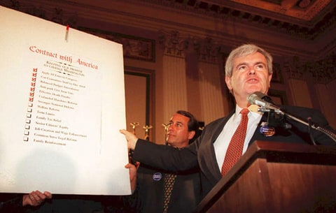 Newt Gingrich holds up a copy of the Republican party's 'Contract With America.'