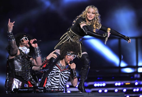 Madonna performs with Redfoo and Sky Blu of LMFAO during the NFL Super Bowl XLVI game halftime show.