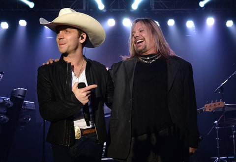 Justin Moore performs with Vince Neil