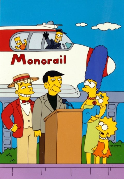 Homer Simpson waves goodbye from a monorail.