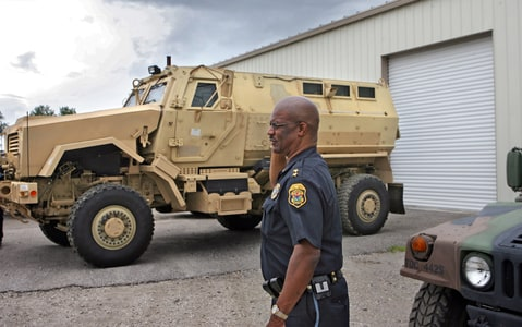 Clearwater Police Chief Anthony Holloway with the department's new MRAP.
