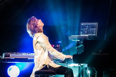 Yoshiki from Yoshiki Classical performs a classical piece in Paris, France on May 26th, 2014.