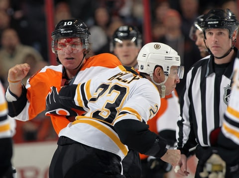 Brayden Schenn of the Philadelphia Flyers is bloodied in a first period fight with Chris Kelly of the Boston Bruins.