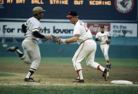 Boog Powell of the Baltimore Orioles tags out a Pittsburg Pirate during the World Series in Baltimore, Maryland in October 1971.
