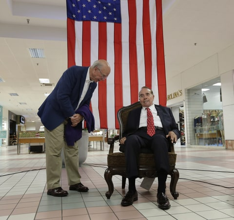 Republican Sen. Pat Roberts chats with former Senate Majority Leader Bob Dole during a campaign stop at a mall in Dodge City, Kan, Monday, Sept. 22th, 2014.