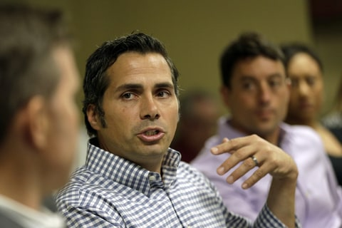 U.S. Senate candidate Greg Orman talks to workers at a healthcare company in Overland Park, Kansas on Sept. 10th, 2014.