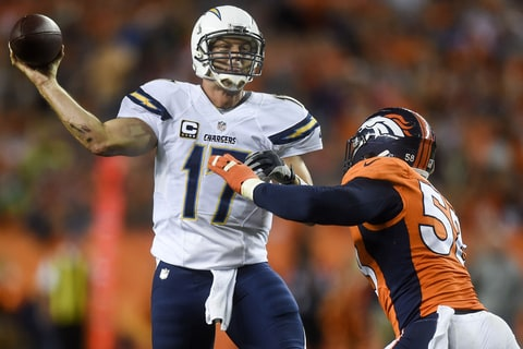 Philip Rivers throws under pressure from Denver Broncos linebacker Von Miller.