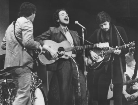 Bob Dylan, Rick Danko and Robbie Robertson performing at the Woody Guthrie memorial concert In New York City's Carnegie Hall on January 20th, 1968.