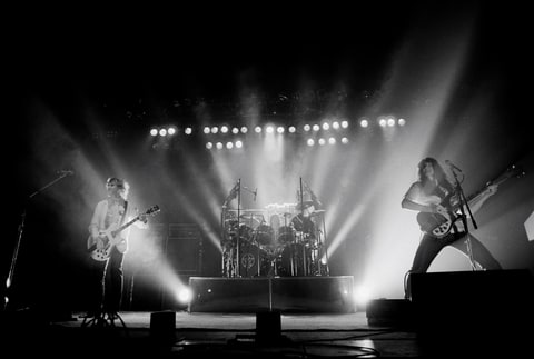 Rush perform live on stage during their Permanent Waves tour in England in June 1980.