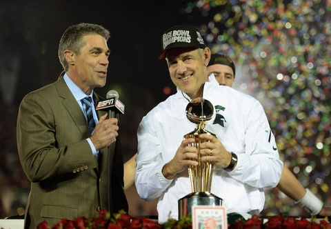 Chris Fowler interviewing Big 10 Conference Michigan State coach Mark Dantonio after winning the Rose Bowl on January 1, 2014 in Pasadena, California.