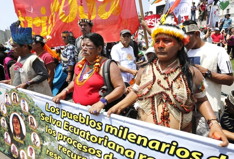 Ecuadorean indigenous environmental activists march at the