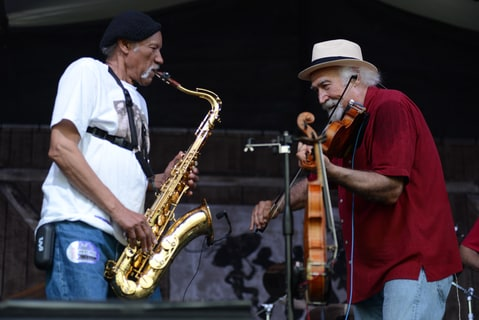 Charles Neville performs with Michael Doucetfrom BeauSoleil