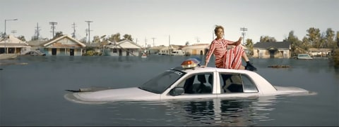 Beyoncé sits on a sinking New Orleans police car in her