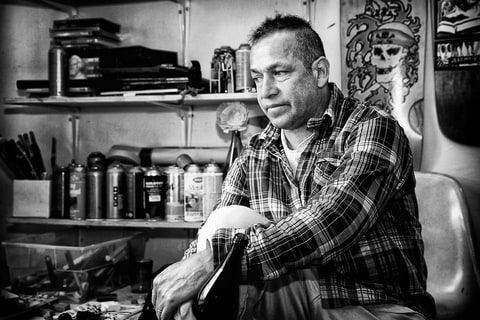 Mark Gonzales Sitting In Home