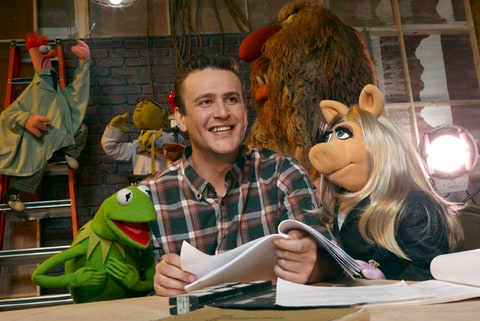 Kermit the Frog, Jason Segel and Miss Piggy in 'The Muppets.'