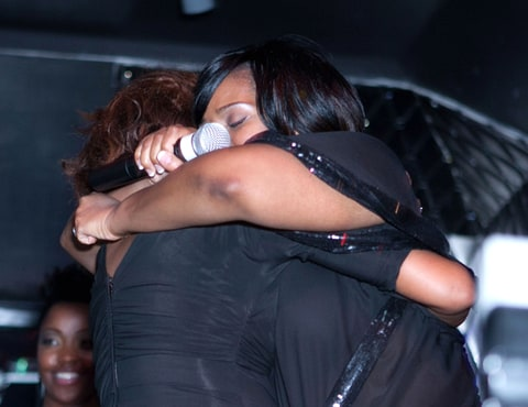Whitney Houston and Kelly Price share the stage at the Kelly Price and Friends Unplugged: For The Love Of R&B Grammy Party at Tru Hollywood.