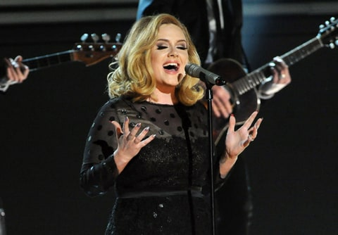 Adele performs at the 54th Annual Grammy Awards.