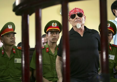 Gary Glitter listens to the judge before the guilty verdict is announced at the People's Courthouse in Ba Ria, Vietnam.