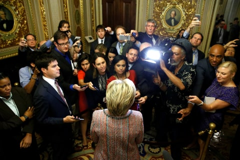 Democratic U.S. presidential candidate Hillary Clinton speaks with reporters as she departs after meeting with Senate Democrats during their luncheon gathering at the U.S. Capitol in Washington, U.S. July 14, 2016.